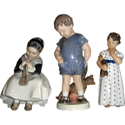 3 Beautiful Royal Copenhagen Figurines - Girl Sewing, Boy with Bear, Girl with Doll