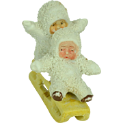 Two Snow Babies on a Sled, German