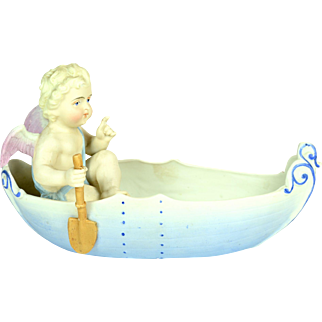 "German All Bisque Angel In Boat, 8"" long, Ca. 1890"