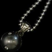 Artisan Black Pearl Pendant Studded with Diamonds  14 karat gold Earrings