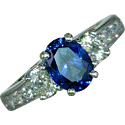 Blue Sapphire and Diamonds Trellis Style Three Stone Ring featuring an Oval Sapphire 1.77Cts, 2 Diamonds 0.52 CTW, 8 Diamonds 0.25 CTW, Size 7.5