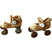 Tiny antique doll roller skates