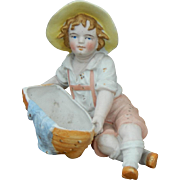 Antique bisque boy with boat