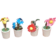 Vintage dollhouse paper flowers in clay pots