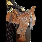 Small vintage leather saddle