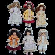 Vintage dollhouse all bisque dolls