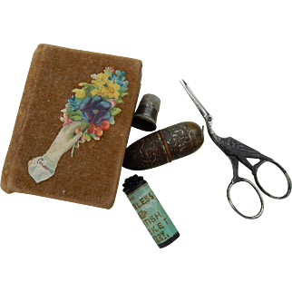 Small antique sewing kit for bebe
