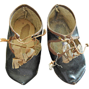 Antique French oil cloth doll shoes