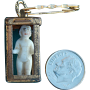 Old frozen Charlotte doll pin