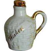 "Old doll's ""wiskey"" whiskey jug"