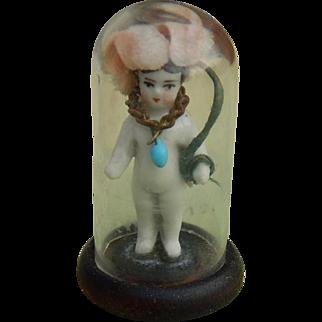 Frozen Charlotte doll glass dome