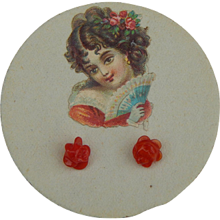 Antique doll earrings on card #1