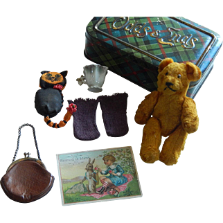Antique doll accessories in biscuit tin