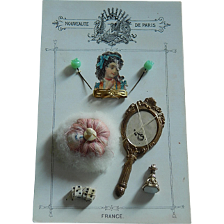 Antique French fashion accessories on card