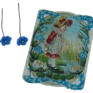 Antique forget-me-not doll earrings on card