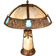 Slag Glass Panel Lamp with Scenic Filigree Border and Multi-Color Glass and Lighted Base