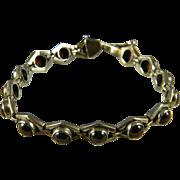 Comfortable Sterling And Garnet Bracelet