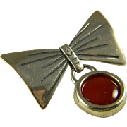 Mid Century Sterling Bow Pin With Carnelian Charm