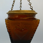 Small religious sanctuary lamp in impressed amber glass