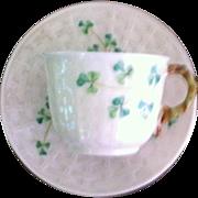 Delicate Belleek demitasse in the shamrock/basketweave pattern with green mark