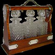 English Oak Tantalus Silver Mounts 3 Cut Glass Decanters and Key