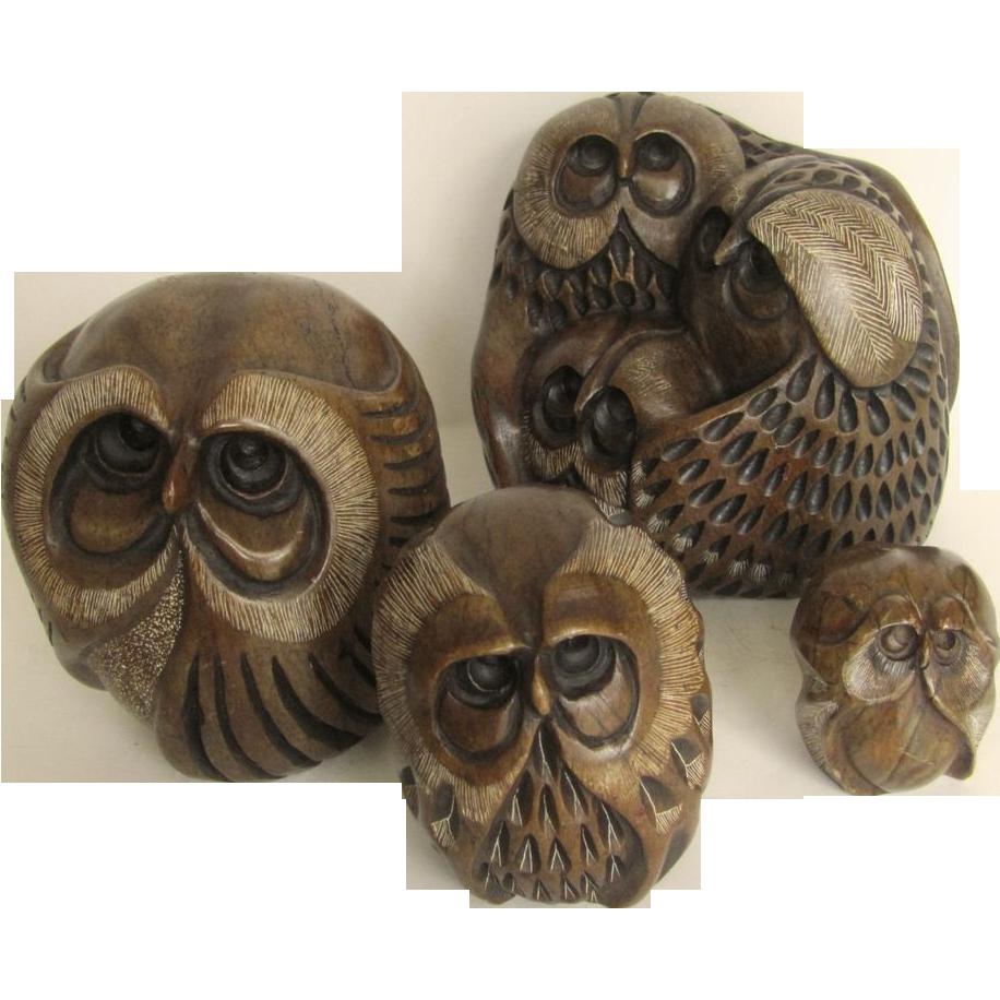 Carved stone owl sculptures by glenn heath california