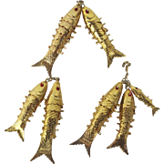 Seven Articulated Gold Tone Fish with Red Eyes