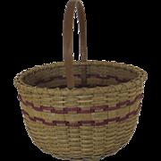 Woven Oak Splint Market Basket. Bentwood handle, bentwood wrapped rim and alternating bands of blue dyed weaving