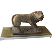 Folk Art Carved Lion on Lucite Base