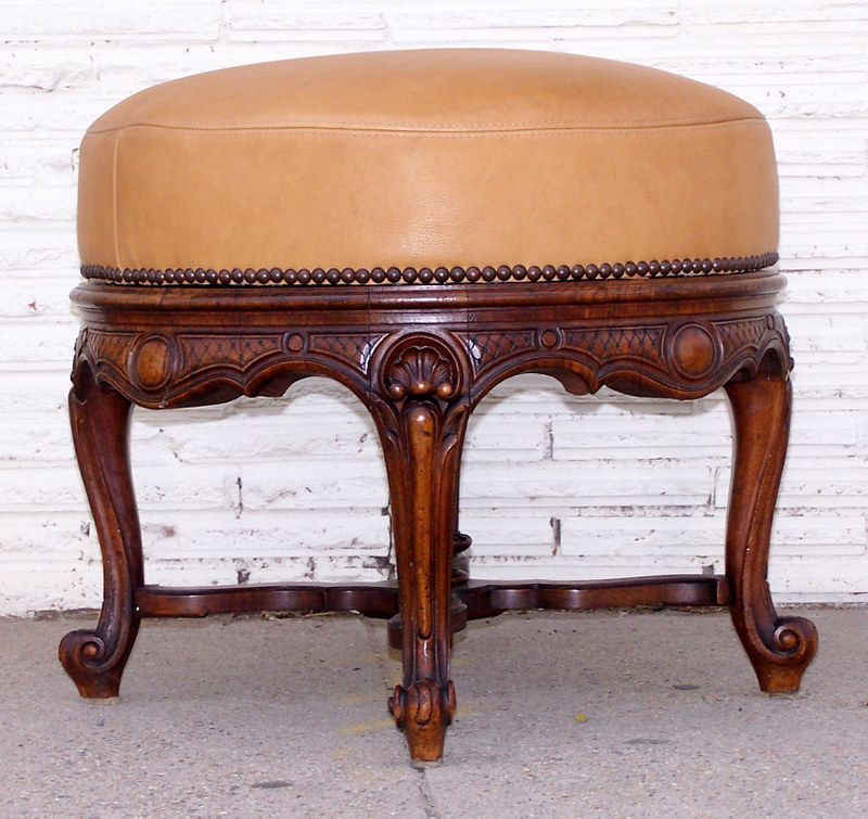 Round Ottoman with Carved Legs and Leather Upholstered Seat