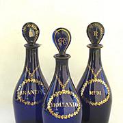 Set of Three Decanters Cobolt. Rum, Hollands, Brandy.