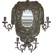 Very Large 19th Century Silver Plate Repousse Four Arm Wall Sconce with Center Oval Beveled Mirror Angels Putti Cherubs Dolphins