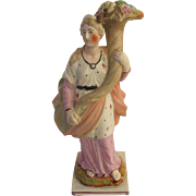 Staffordshire figurine of Fiona with cornocopia probably by  Ralph Wood