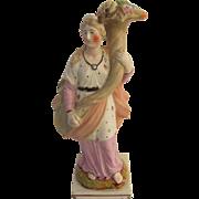 Staffordshire figurine of Fiona with cornocopia probably by  Ralph Wood