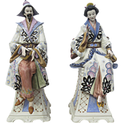 Pair of Large Porcelain Garden Seated Oriental Figures