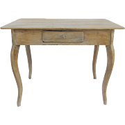 19th Century European side table has a limed finish, giving a wonderful weathered feel to the table.
