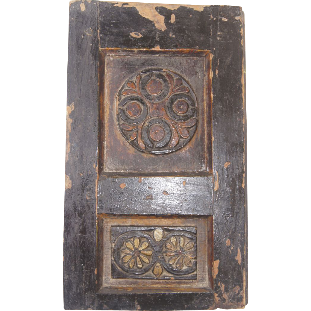 Th century small carved painted panel from blacktulip on