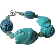 Carved Buddha Head Charms with Turquoise Bead Bracelet, 9""