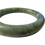 Chinese Green and White Speckled Jade Tubular Bangle Bracelet, 58mm