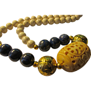 Chinese Money Bat Carved on Ivory-Like Bone Bead with Lapis-Howlite-Brass Bead Necklace, 21""