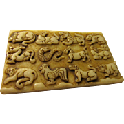 Carved Animals of the Asian Zodiac on White Jade Tablet
