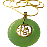 Green Jade Ring Pendant with Good Fortune Symbol Center on Gold Tone Snake Chain, 16""