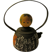 """3 1/4"""", Japanese Kokeshi Doll Sitting in Black Tea Kettle Covered with Poetry Writings"""