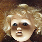 "18"" Celluloid shoulder head doll glass eyes"