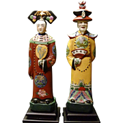 Porcelain Oriental Couple Statues on wooden pedestals.