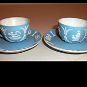 Two Wedgwood Jasperware Miniature Blue Cups and Saucers