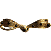 Art Nouveau Gilded Dragonfly Brooch- Glass Amethysts and Emeralds. Circa 1900.