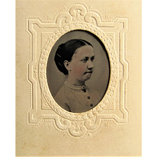 Tintype Of Young Lady In Impressed Decorated Sealed Paper Sleeve.