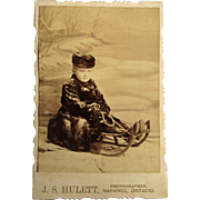 Cabinet Card Photograph- Little Boy From Canada on Sled-Winter Scene.