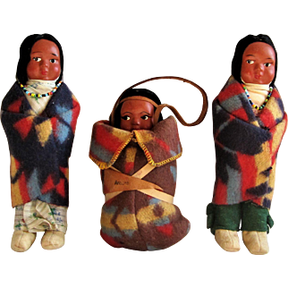 A family of Three Native American Indian Themed Skookum Dolls.